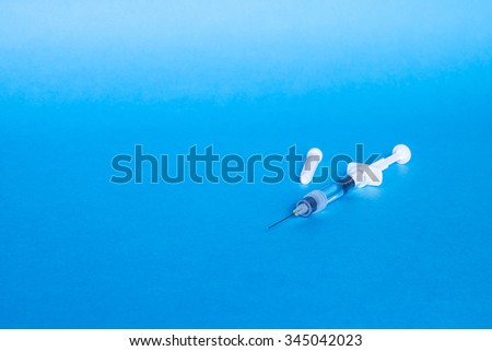 Syringe, medical injection. Medicine isolated plastic vaccination equipment with needle on blue background. Liquid drug or narcotic. Health care in hospital. - stock photo