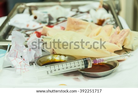 syringe with needle use for xylocaine injection in laceration wound - stock photo