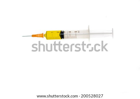 syringe with potent yellow colored medicine - stock photo