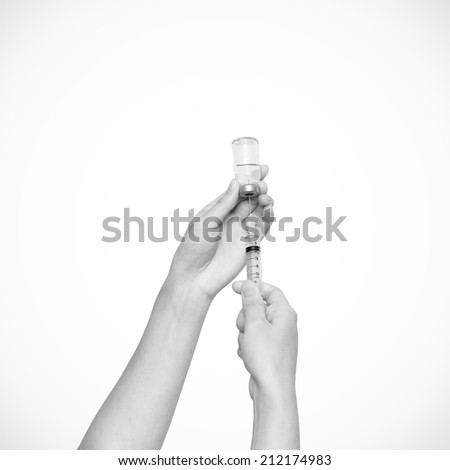 Syringe with vial on hands of a nurse,doctor administer the injection  isolated on white (with clipping path) - stock photo