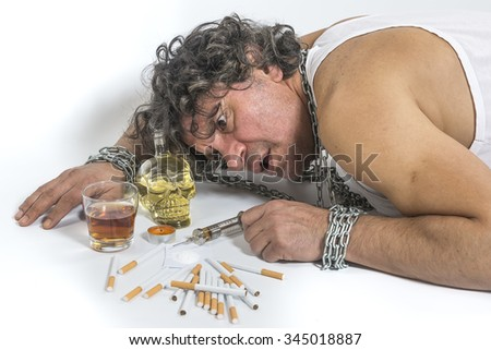 Syringes, Alcohol, Drugs, Heroin addict man in bad habits and background. - stock photo