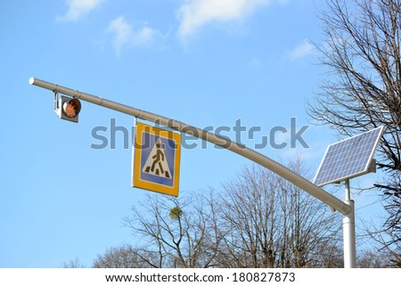 """System of pulse indication on the basis of the traffic light on the solar Solar Traffic Light battery and a road sign """"Crosswalk"""" - stock photo"""