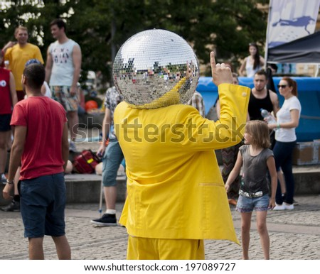SZCZECIN, POLAND, MAY 23, 2014: Juwenalia, is an annual students' holiday in Poland, usually celebrated for three days in late May. Disco Ball Man dancing in the street. - stock photo