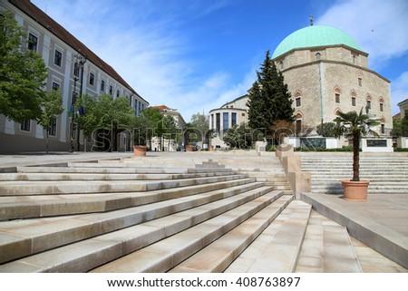 Szechenyi Square and Mosque of Pasha Qasim in Pecs, Hungary - stock photo