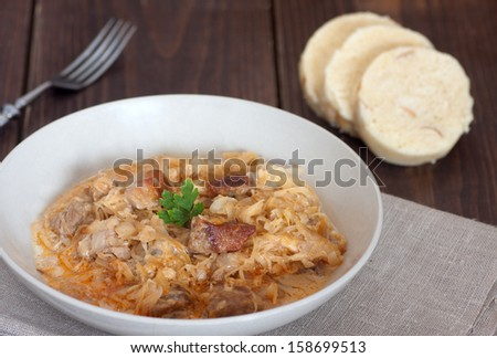 szeged gulyasz - pork goulash with pickled white cabbage (sauerkraut) and dumplings - stock photo
