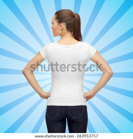 t-shirt design, advertisement and people concept - woman in blank white t-shirt over blue burst rays background from back - stock photo
