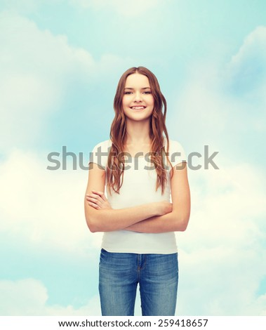 t-shirt design concept - smiling teenager in blank white t-shirt with crossed arms - stock photo