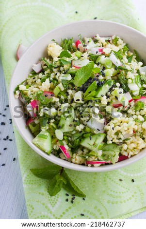 Tabbouleh style salad made with millet and vegetables - stock photo