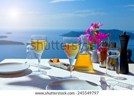 Table above sea for two. Greece, Santorini island - stock photo
