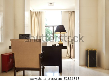 Table and armchair in my office - stock photo