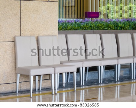 table and chair in restaurant with flowers - stock photo