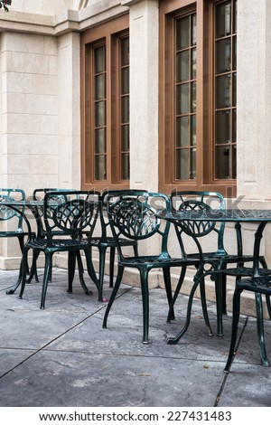 table and chairs at a restaurant - stock photo