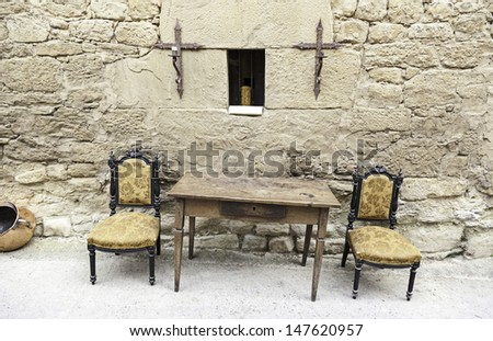 Table and chairs of the Inquisition, detail of a scene from the old Spanish Inquisition, religicion and furniture - stock photo