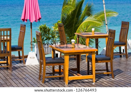 Table and chairs with a beautiful sea view on island Koh Phangan, Thailand. - stock photo