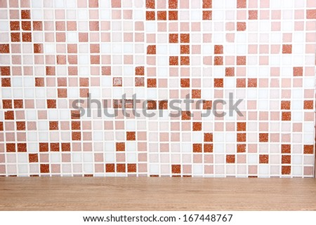 Table and mosaic tiles in kitchen close-up background - stock photo