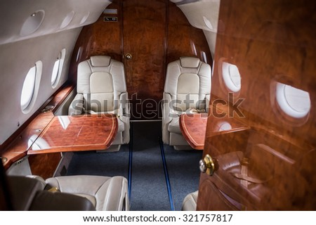 Table and seats inside of small business jet - stock photo