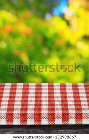 Table and sunny nature leaves background - stock photo