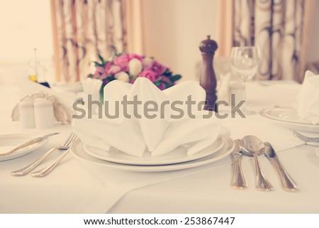 Table arrangement in an expensive haute cuisine restaurant, toned image - stock photo