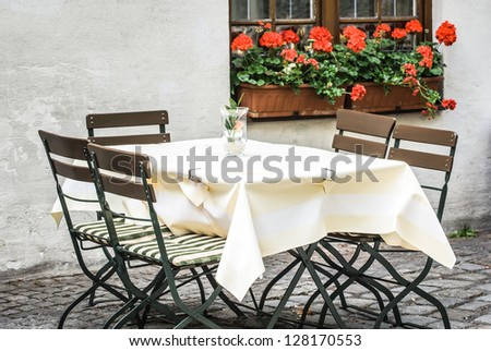 table at a sidewalk restaurant - stock photo