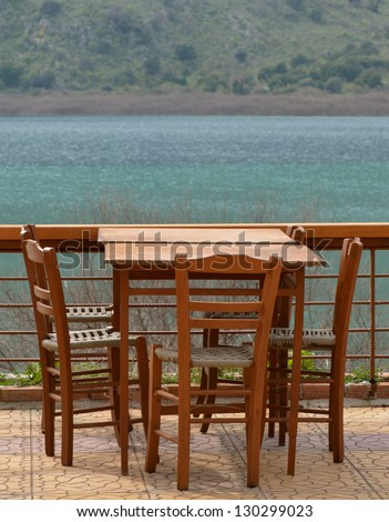 Table at Lake Kournas Crete - stock photo