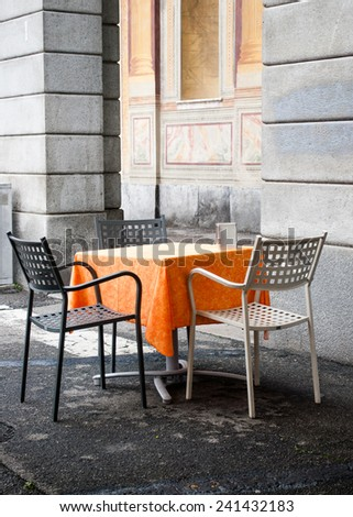Table at the outdoor cafe - stock photo