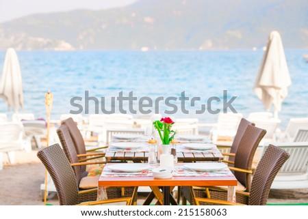 table cafe on the beach near the sea - stock photo