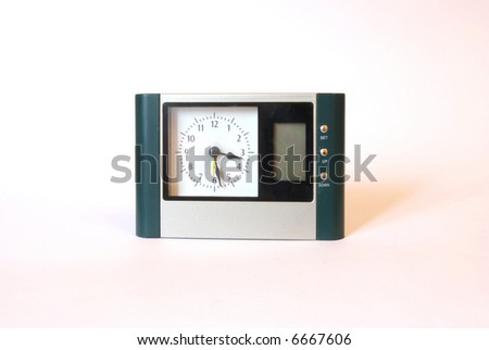 Table clock on a white background - stock photo