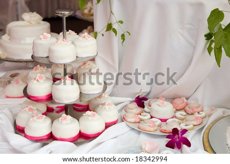 Table decorated with wedding cakes - stock photo