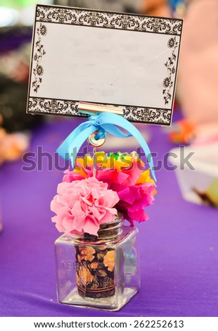 Table decoration flower made from tissue with copy space - stock photo