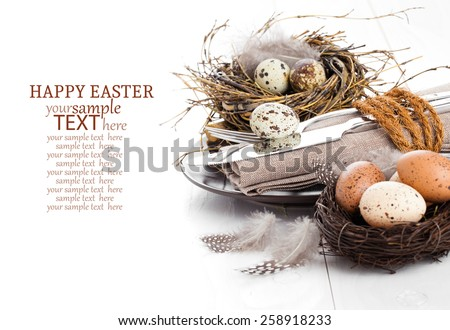 table decoration on white wooden background with quail eggs - stock photo