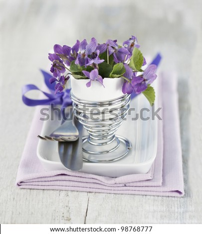 Table Decoration with Viola Flowers - stock photo