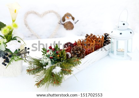 Table decorations on snow garden table - stock photo
