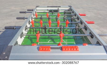 Table football aka table soccer, foosball from the German Tischfussball, baby-foot or kicker table-top game and sport - stock photo