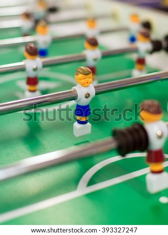 Table football board game with plastic players. - stock photo