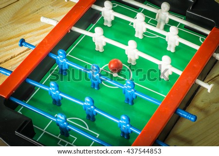 table football game.Soccer game toys On the wooden floor.Customize colors retro. - stock photo