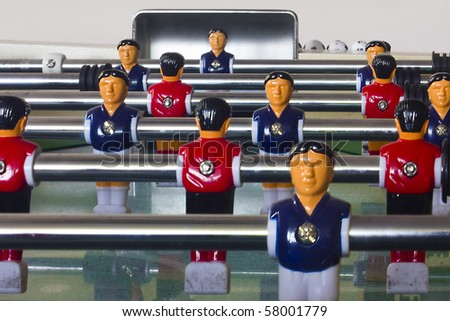 Table football or soccer, with blue and red players - stock photo