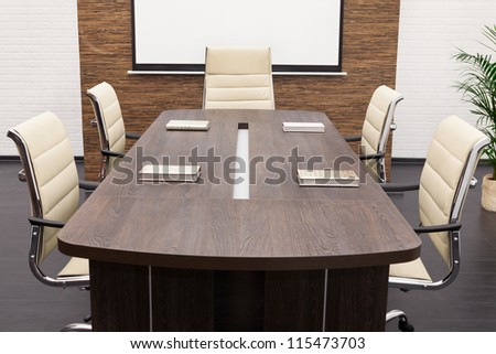 table for negotiations with the screen in the office - stock photo