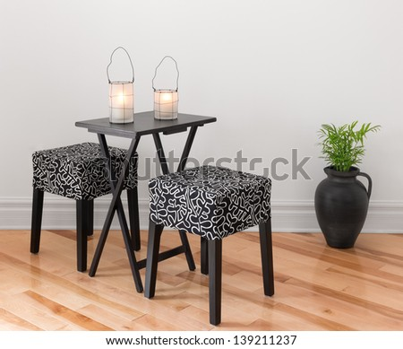 Table for two decorated with lanterns. Simple design. - stock photo