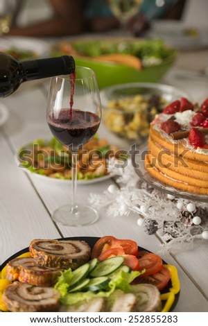 Table full of meals and wine. Celebration day - stock photo