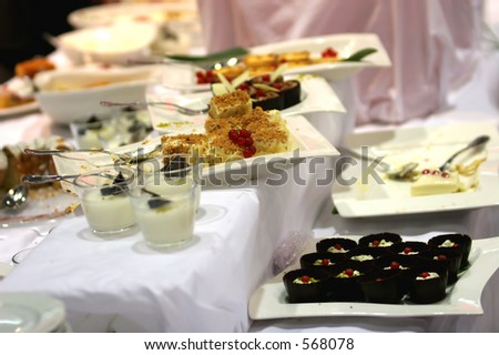 Table full of various sweets - stock photo
