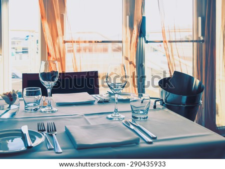 table in stylish restaurant, Jersey Island  - stock photo