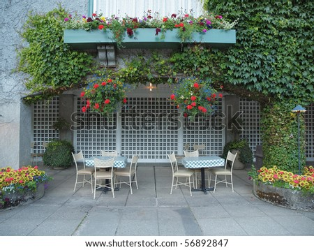 Table in the outdoor cafe ready for a meal on the terrace - stock photo