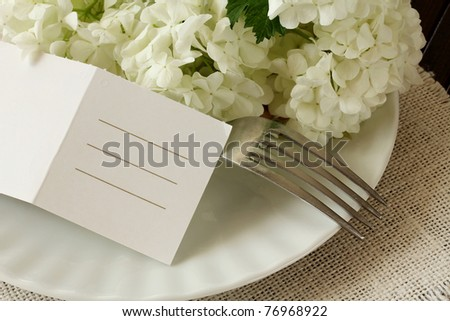 Table Laid For wedding , A Romantic Dinner or other events. Table Setting with flowers and empty card for your text - stock photo