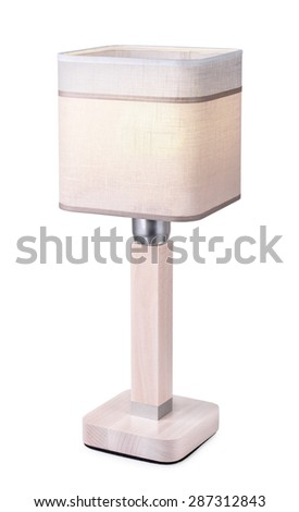 Table lamp with linen lampshade isolated on white - stock photo