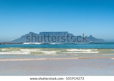 Table Mountain, Cape Town, South Africa seen from Bloubergstrand - stock photo
