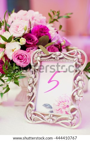 table number and flower composition - stock photo