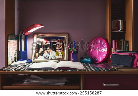 Table of a child, place in kid's room for doing school homework and learning. - stock photo