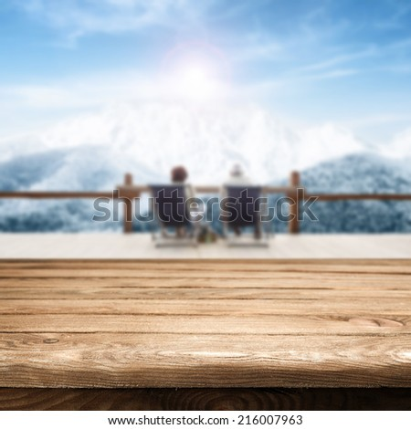 table of brown sky of blue and white mountains  - stock photo