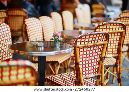 Table of cozy Parisian restaurant decorated with little flower pot - stock photo