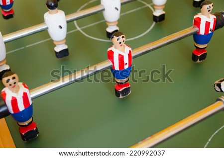 Table of foosball. Miniature game of soccer for recreation - stock photo
